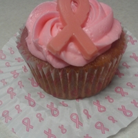 Breast Cancer Awareness Donation Raspberry cupcakes with white chocolate frosting, and a chocolate ribbon, simple....but sooooo yummy - donated for a fundraiser.