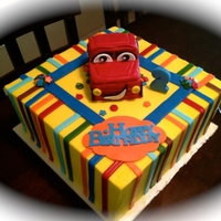 Zach's 2Nd Birthday Cake This was done in buttercream with fondant stripes. The car was done with RKT.