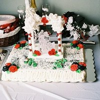 Elegant Black And Red Wedding black and red wedding cake with strawberry filling and buttercream icing