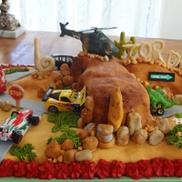 Cars Desert Scene Cake I   Landscape is the chocolate mud cake. The cars belong to Jordan he wanted me to use them on his cake...bless him
