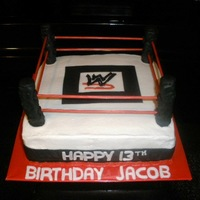 Wwe Cake Buttercream, ring is made from crispy treats covered with fondant and wooden skewers painted with food color