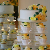 Teacup Wedding Cakes Top tier traditional fruit with lemon and chocolate cupcakes inserted into teacups with saucers.