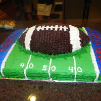 Football Birthday Cake   sheet cake with Wilton First and Ten football pan decorated in Buttercream and White chocolate buttercream icing.