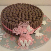 Baby Girl's Christening Cake double chocolate chip fudge cake with chocolate fingers and malteasers on top!!