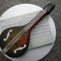 Mandolin Cake yep it's all cake, including the music pages......and just to make sure they did the right thing........I made the strings from dental...