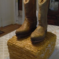 Cowboy Boots On Bale Of Hay! This was made for a Dad Dude's 60th Birthday. Boots made of rice krispie treats and chocolate for the soles. Bale of Hay is all cake...