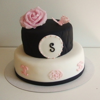 Black/white With A Little Bit Pink birthday cake with a touch of chanel and icing butterfly attemp