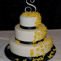 Our First Wedding Cake Bride wanted black and yellow, and she picked out the flowers. She was very happy, so we were pleased as well.