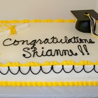 Shianne's Graduation Cake - Pueblo East High Full two layer sheet cake (24x16). One half is triple chocoalte fudge, the other white, both WASC versions. Vanilla buttercream.