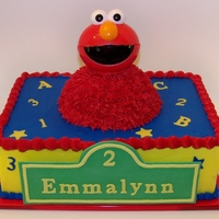 Elmo Birthday Cake White vanilla sour cream cake, strawberry filling, vanilla buttercream. Fondant decorations. Elmo's body is also cake. His little head...