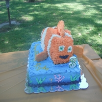"Nemo Birthday Cake Nemo Birthday cake for my daughter's 3rd birthday. Funfetti 15x11"" Sheet Cake with 10x7"" Pound Cake Nemo on top."