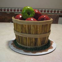 Apple Basket Cake Here is an apple basket cake I made. Basket sides are fondant. Apples are rice crispies covered in frosting, then wrapped in fondant.