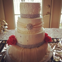 Old Hollywood Inspired Wedding Cake  This old hollywood inspired cake has fondant pleating, diamond studs, a fondant swag with a diamond/pearl combo brooch, and simple scroll...