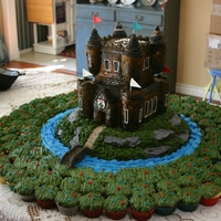 Scottish Castle Cake I made this castle cake for some dear friends. The landscape was made up of 120 cupcakes.