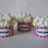 "Popcorn yellow cupcakes topped with ""popcorn"""