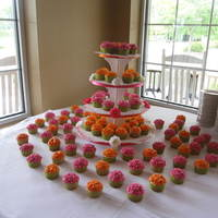 Wedding Cupcakes 8 dozen cupcakes in fuschia and orange colors to match the bridal colors and buttercream piped to look like carnations