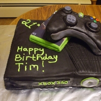 Xbox Birthday Cake This cake was for a friend's son. I only made one other cake with fondant before this, and that was in class. The xbox is neon green...