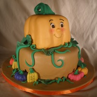"Spookley The Square Pumpkin  Spookley topper on a 10"" round cake. Both are lemon sponge cake with cream cheese icing. Mini pumpkins are made with a gum paste/mmf..."