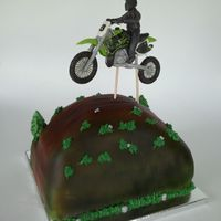 Dirt Bike Cake This cake was for a 13th birthday. The birthday boy got a new dirt bike as a gift and his mom thought it would be fun to have a cake that...