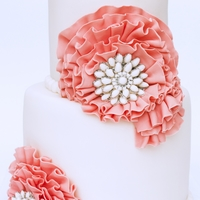 Rosettes White wedding cake with coral rosettes
