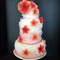 Ruffles And Roses Blush Pink to white Ombre' ruffles with red, pink, and peach Juliet roses Wedding cake.