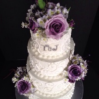 Buttercream Scroll Cake With Purple Roses Hydrangeas And Berries Buttercream scroll cake with purple roses, hydrangeas and berries
