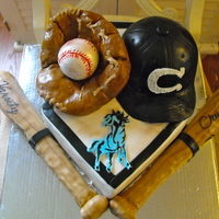 Baseball Cake Home plate and baseball hat made from cake and bats, ball, mitt made out of cereal treats.