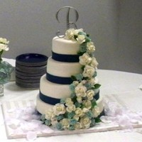 Blue And White First wedding cake I've made with gum paste roses and carnations. Made for my daughter's wedding.