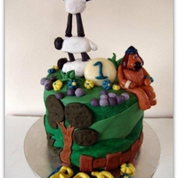 Shaun The Sheep Cake All edible, handmade fondant figures, dog is modelling chocolate. Chocolate cake with chocolate buttercream