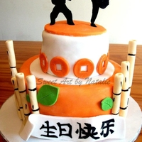 "Kung Fu Cake All edible. Silhouettes cut out by hand. Sign on front says ""Happy Birthday"" in Chinese. Kiwi cake with Kiwi buttercream :)"