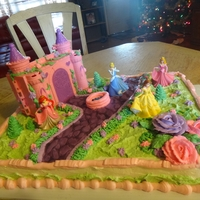 Princess Castle Cake   My daughter's 4th birthday cake. Vanilla cake with buttercream. The cobblestone path is fondant (I used luster dust to add depth).