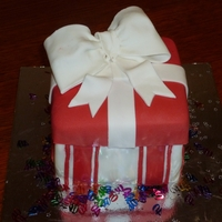 Present Cake   Small version of present cake - chocolate mudcake & ganache with fondant bow & icing.