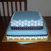 My 2 Boys Baptism Cake  White choc mudcake with white choc ganache & choc mudcake with choc ganache. Fondant icing & decorations. Used a small paper...
