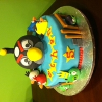 Angry Birds Angry birds cake for a birthday, bomb bird was the favorite. everything edible, the big bomb bird also made of cake. logs and stones in...