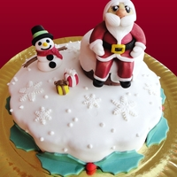 Santa And Frosty Around The Chimney sponge cake filled with ricotta cream and strawberry marmelade
