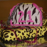 Animal Print Fashionista Cake Leopard print base, with a zebra print cake.