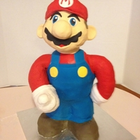Super Mario Cake Mario is a vanilla cake with buttercreme icing, rice krispie treats and fondant. His body, legs and feet are cake. His arms and head are...