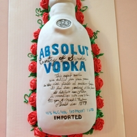 Absolut Vodka Cake This vanilla cake has a raspberry filling and buttercreme icing. The roses are buttercreme.