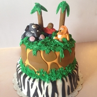 1St Birthday Jungle Themed Cake This birthday cake was a little boy's 1st birthday. The bottom tier is vanilla cake and the top tier is red velvet. It has buttercreme...