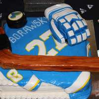 Hockey Grooms Cake This groom was a huge hockey fan. His favorite team is the St. Louis Blues so I made him a puck, stick, glove and a jersey with his name...