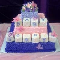 Baby Blocks Baby Shower Cake The theme for this baby shower was flowers, butterflies, pink and purple. So girly and so fun!