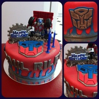 Transformer Themed Cake  This is a cake order for a friend's friend. Transformer Theme Cake - Chocolate cake, all decorations are made of fondant except the...