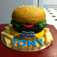Burger Cake  I thought of making this cake for a special friend because he loves burger! Burger bun is marble cake and burger patty is chocolate cake. I...