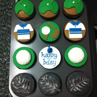 Golf & Nz Silver Fern Theme Cupcakes  Chocolate Cupcake Golf & NZ Silver Fern Theme. All decorations are edible - fondant & metallic silver dust.Cupcake order by: Una (...