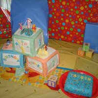 Pooh's 1St Birthday 3 ABC blocks made from a total of 6 cakes covered with white fondant, the borders around the blocks is one piece of fondant, then babies...