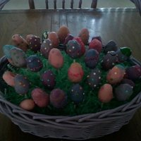 Easter Eggs For A Crowd Cake balls shapped like eggs on candy sticks, dipped in melted candy chocolate