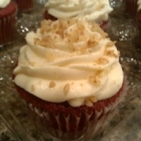 Red Velvet Cupcakes Moist red velvet cupcake topped with buttercream icing and chopped pecans