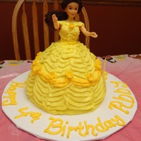 Abby's 4Th Birthday This was made using the doll dress cake pan. It was a princess theme this year and my niece wanted a princess Belle cake. This cake was...