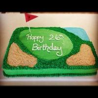 "Greg's Birthday This was a 1/2 sheet cake. The ""sand traps"" are made with crushed vanilla waffer cookies."
