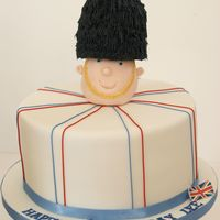 British Guardsman Cake   I made this cake for a former British guardsman. Cake covered in fondant, hat made of rice krispie treats and decorated with royal icing